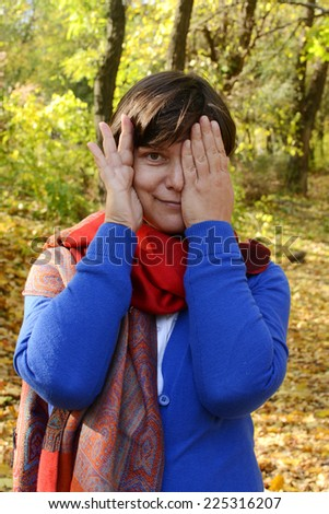 Funny woman in autumn park - stock photo