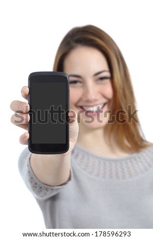 Funny woman showing a blank smart phone display application isolated on a white background            - stock photo