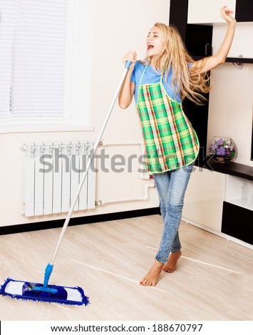 Funny woman with mop. Female cleaning home - stock photo