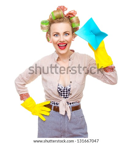 Funny young cheerful housewife with gloves holding rag / wipe, isolated on white. Pin-up girl - stock photo