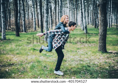 Funny young couple in love walking in the spring park  - stock photo