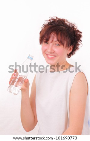 Funny young girl with a bottle of mineral water - stock photo
