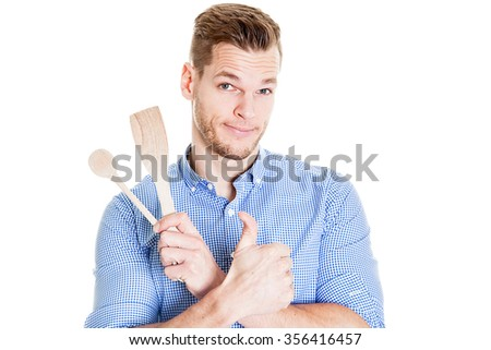 funny young man with kitchen tools - stock photo