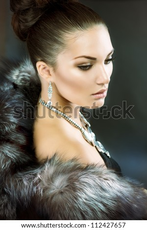 Fur Fashion.Beautiful Woman in Luxury Fur Coat - stock photo