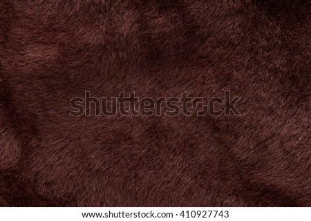 Fur sheepskin burgundy. Texture, background - stock photo