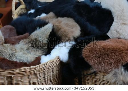 fur sweater in basket  - stock photo