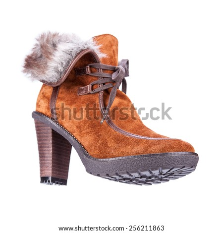 fur women's winter boots with soles shot on a white background - stock photo