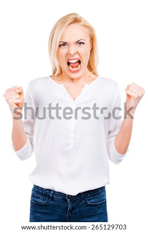 Furious beauty. Angry mature woman keeping eyes closed and covering ears with hands while standing against white background   - stock photo