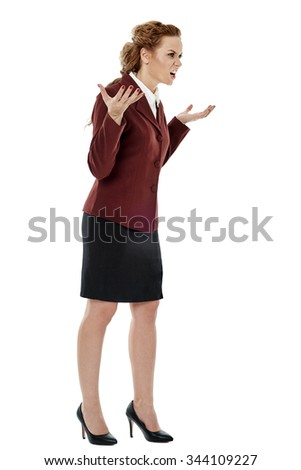 Furious businesswoman in full length, yelling, isolated on white - stock photo