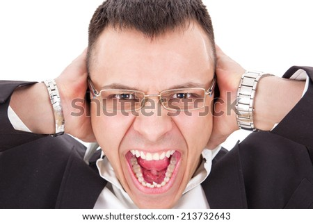 furious man with glasses yelling holding hands on his ears - stock photo
