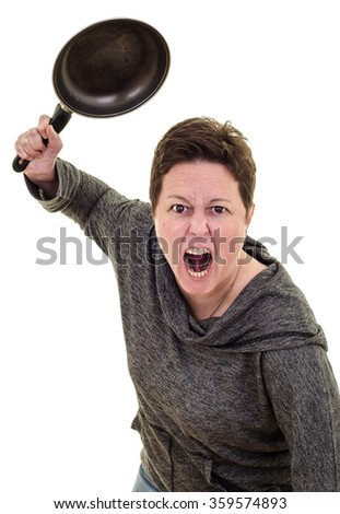 Furious woman swinging a frying pan in a fit of rage. White background with copy space - stock photo