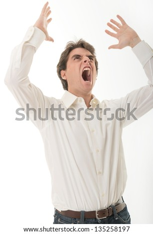 Furious young man, yelling - stock photo