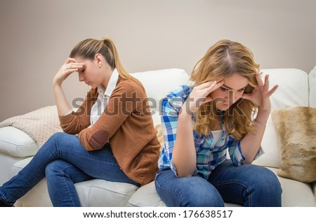 Furious young mother in a discussion with her teenage daughter. Problems between generations concept - stock photo
