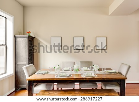 Furnished Dining Room with Place Settings in New Home - stock photo