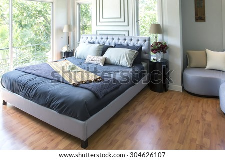 Furnished master bedroom in new luxury home. - stock photo