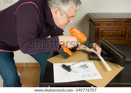 furniture fitter - stock photo