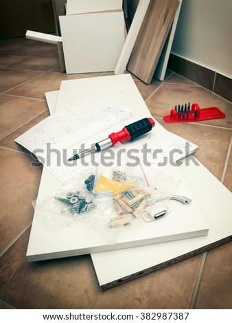 Furniture parts and tools before star of mounting furniture. - stock photo