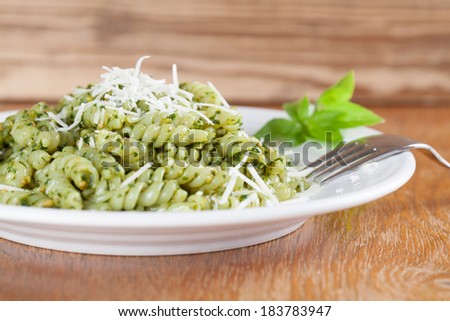 Fusilli with freshly made pesto genovese and grated parmesan - stock photo