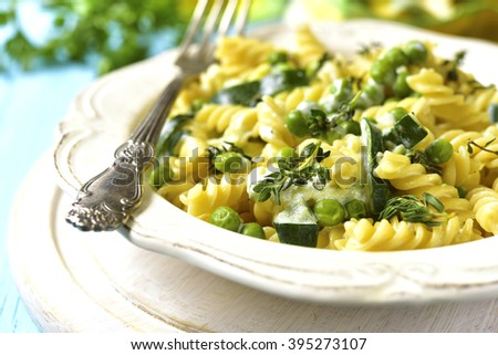 Fusilli with zucchini,green pea and thyme in a cream sauce. - stock photo