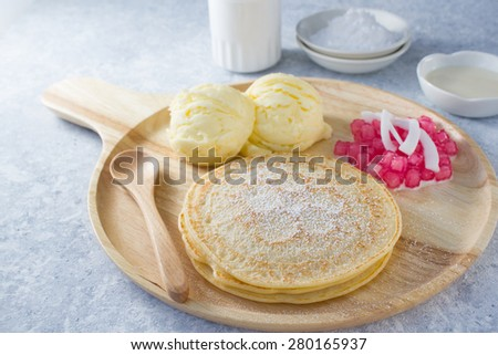 fusion mix dessert : pancake , iccream and  water Chestnuts in Coconut Milk (tubtim grob) - stock photo