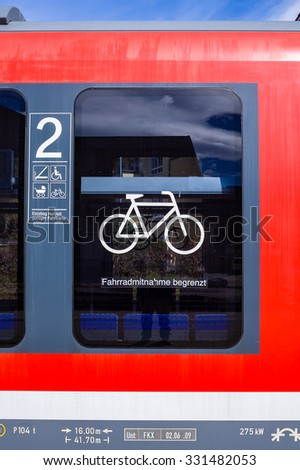FUSSEN, Germany - March 29, 2015: One of the cabinet indicates that the train can bring your bike on, supporting the use of clean energy, energy conservation and the environment and tourism. - stock photo