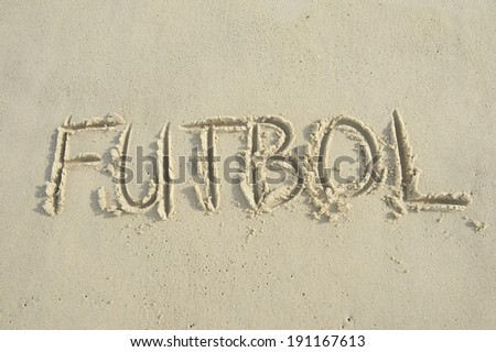 Futbol football handwritten soccer message in capital letter text on bright sunny South American sand beach - stock photo