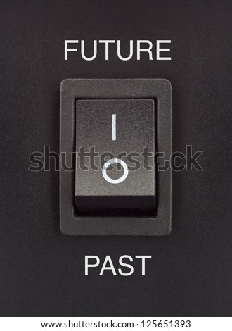 Future or past black toggle switch on black surface positive negative - stock photo