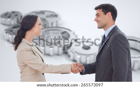 Future partners shaking hands against cogs and wheels - stock photo
