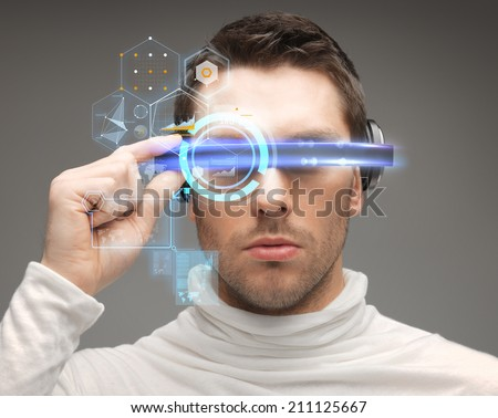 future, technology and people concept - man in futuristic glasses - stock photo