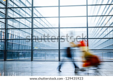 Futuristic  Airport interior people walking in motion blur - stock photo