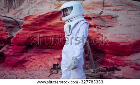 futuristic astronaut on crazy pink planet, image with the effect of toning - stock photo