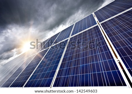 Futuristic concept of solar panels as a future electrical power generators dominance on our planet to produce electricity overcoming current ecological problems like global warming. - stock photo