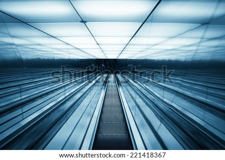 futuristic escalator ,abstract space in a modern building  - stock photo