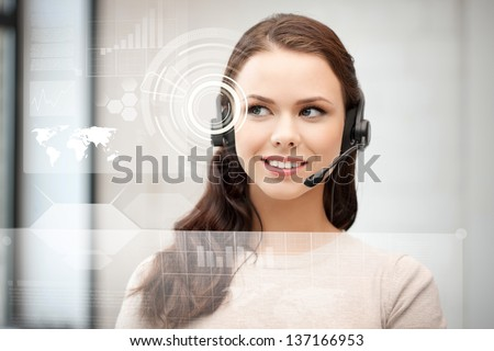 futuristic female helpline operator with headphones and virtual screen - stock photo