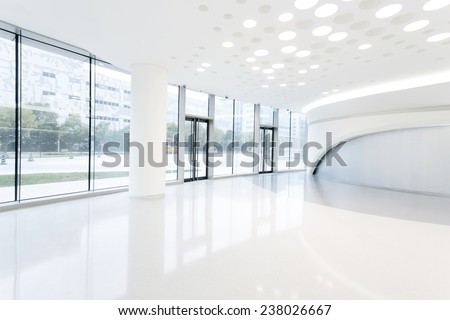 futuristic modern office building interior in urban city  - stock photo