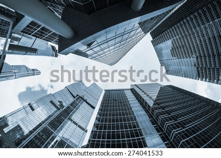 futuristic modern skyscrapers of glass and metal. Focus on buildings. toned photo - stock photo