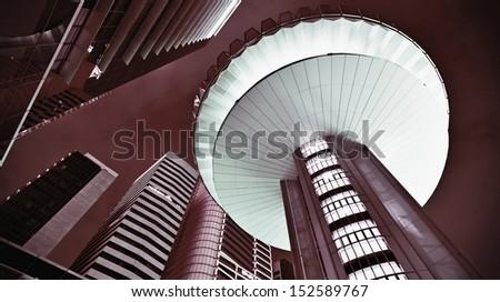 Futuristic office buildings exteriors at night. - stock photo