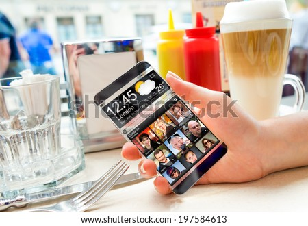 Futuristic Smart phone with a transparent display in human hands. Concept actual future innovative ideas and best technologies humanity. - stock photo