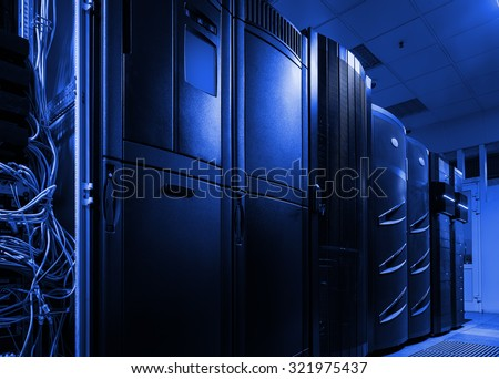 futuristic view of server room in data center with rows mainframes - stock photo