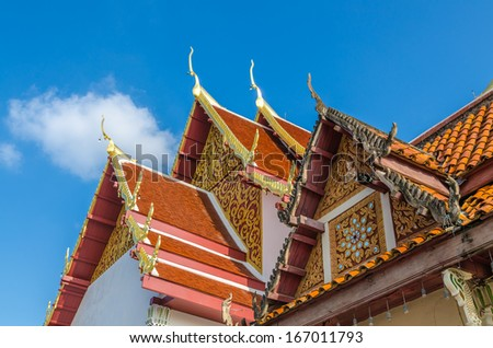 Gable roof on Thai temple in Wat Phra That Cho Hae (the Royal Temple), Phrae Province, Thailand - stock photo