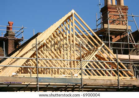 Gable roof timber frame under construction - stock photo