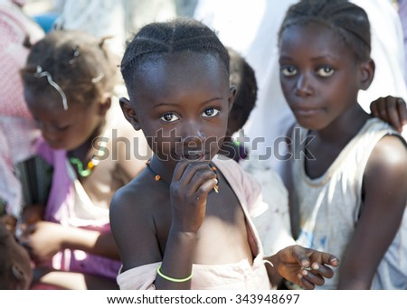 GABU, GUINEA-BISSAU - APRIL 8, 2014: portrait on an African Kid of Fula ethnicity smiling to camera, review of daily life of local people in rural Guinea-Bissau - stock photo