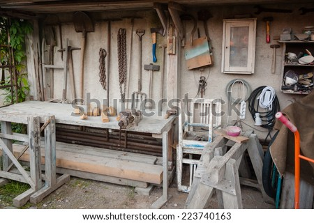 Gadgetry workbench and home tool shed with implements - stock photo