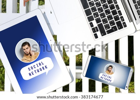 Gadgets with social network on screens - stock photo