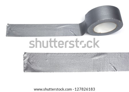 Gaffa tape, silver, from a roll and a stripe glued to the underground, isolated on white background - stock photo