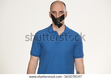 Gagged man unable to speak - stock photo