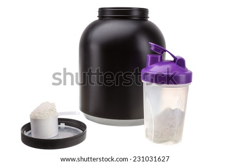 Gaining muscle mass. Protein and shaker for fitness and bodybuilding. - stock photo