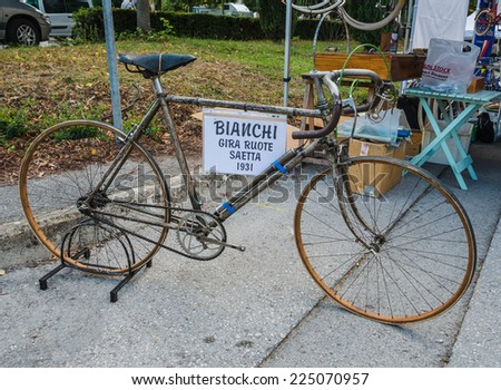 GAIOLE IN CHIANTI, ITALY - 4 OCT. 2014: Vintage bicycle on display at L'Eroica, a  historic cycling event for owners of vintage bicycles who ride through Tuscany on white gravel roads. - stock photo
