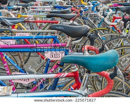 GAIOLE IN CHIANTI, ITALY - 4 OCT. 2014: Vintage bicycles nicely parked before the start of L'Eroica, a historic cycling event for owners of vintage bicycles who ride through the province of Tuscany - stock photo