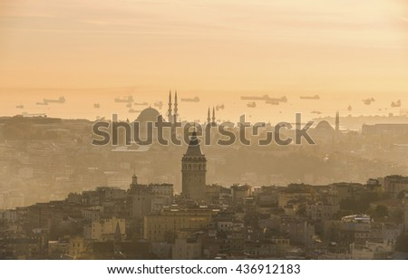 Galata Tower and mosque panoramic view at sunset, yellow backround, Istanbul Turkey - stock photo